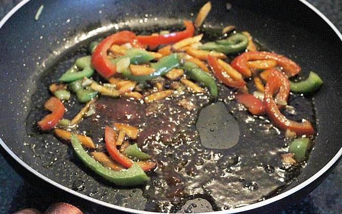 bubbling sauces in pan to season veg hakka noodles