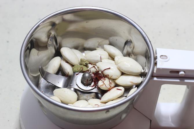 Blending soaked almonds saffron for double ka meetha recipe