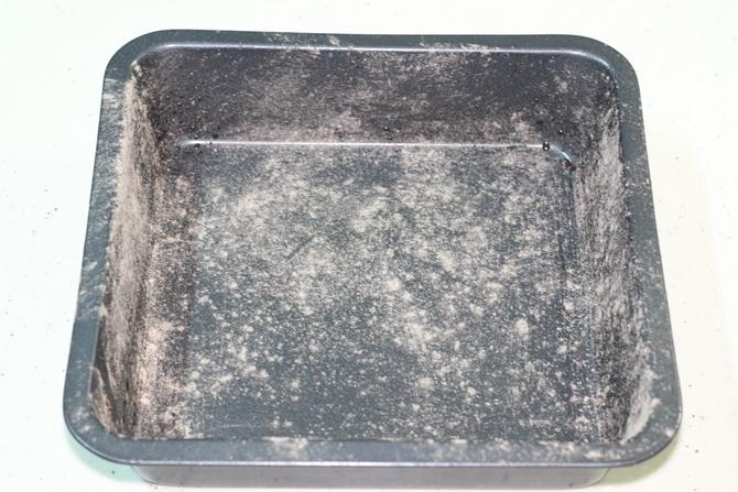 preparing the pan for eggless chocolate banana cake