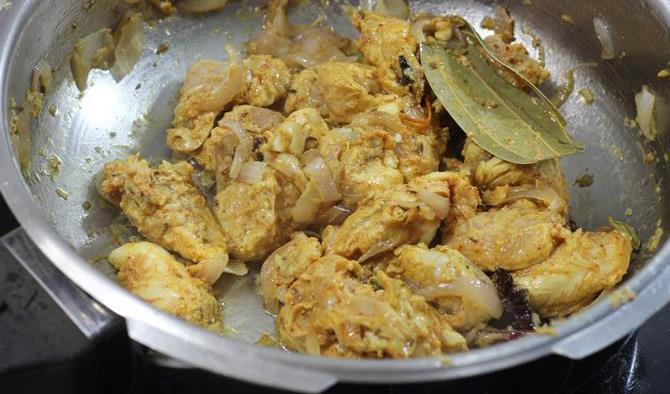 half cooked meat in easy chicken biryani recipe