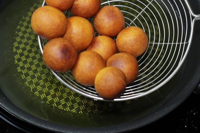 golden fried ghee gulab jamun