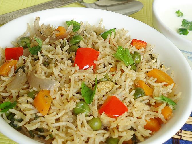 garnishing with capsicum and mint in vegetable biryani recipe