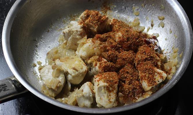 addition of garam masala to make kadai chicken recipe