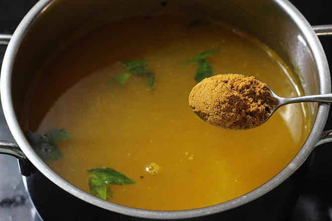 addition of water and rasam powder to make tomato rasam recipe