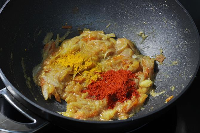 addition of spice powders to make chana masala