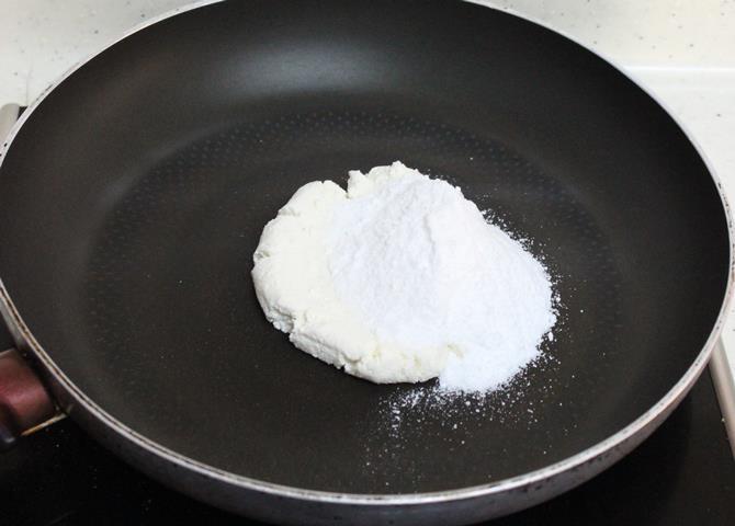 heat paneer in a tawa to make sandesh recipe step by step