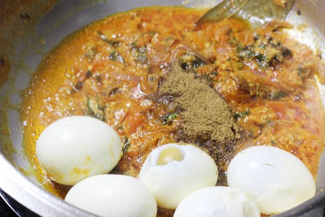 Addition of tomatoes,chili powder, yogurt and mint for muttai biryani