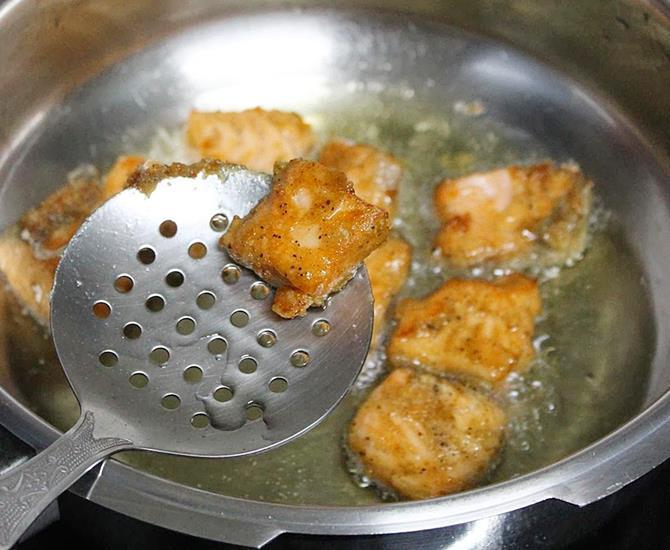 deep frying fillets until golden to make chilli fish