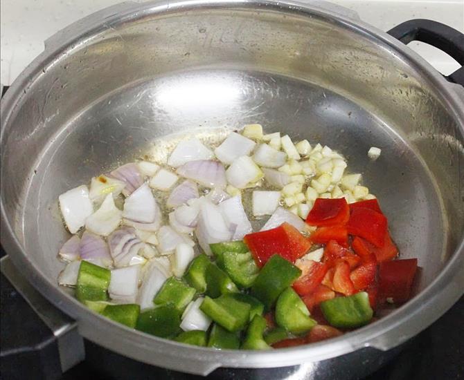 seasoning with garlic onion peppers to make chilli fish recipe