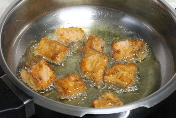 deep frying marinated fillets to make amritsari fish fry