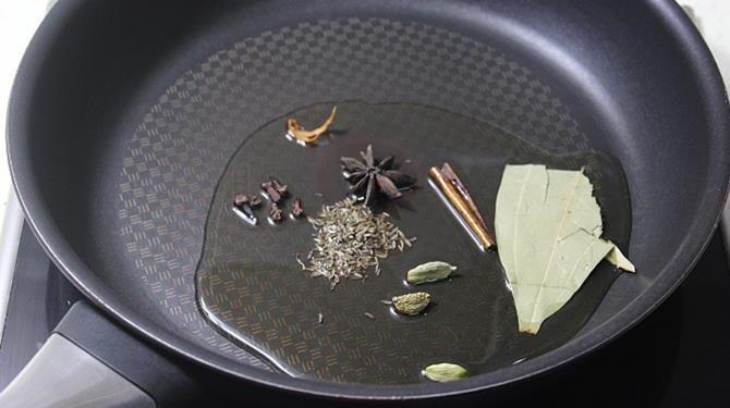 saute spices in oil for making potato rice recipe