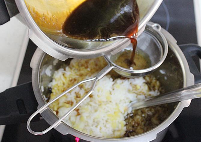 filtering jaggery syrup to make chakkara pongal