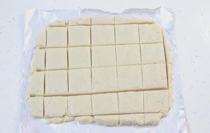 rolling mixture with a pin to make kaju katli