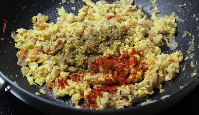 adding spices powders for making egg bhurji recipe