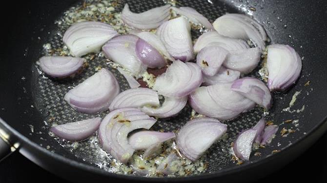 frying onions in pan