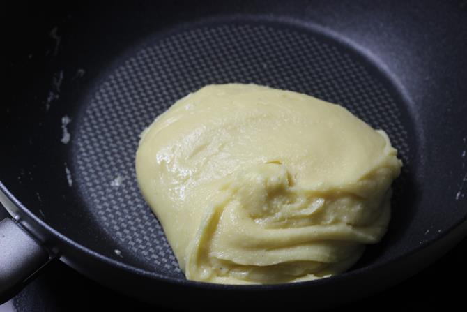stirring consistently the mixture to make mawa barfi recipe