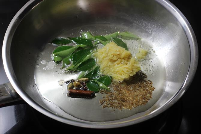 saute dry spices in oil to make pepper chicken recipe