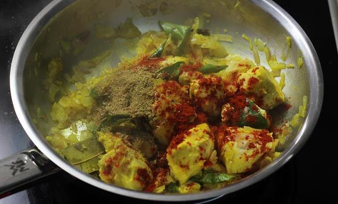 addition of garam masala to make chicken roast recipe