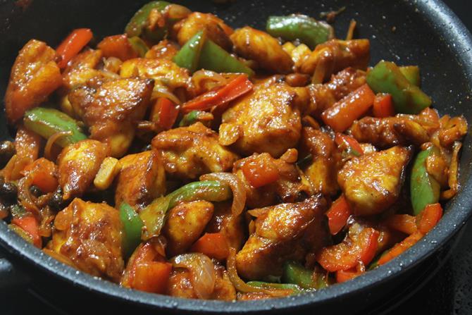 tossing ingredients for schezwan chicken