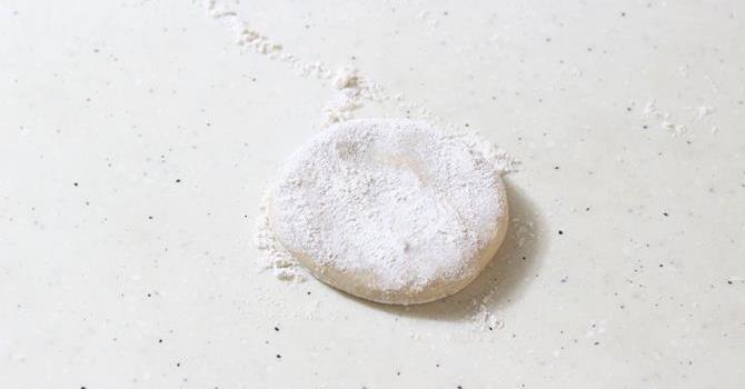 flouring the area for egg paratha recipe