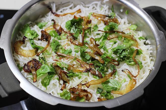 repeat layering cooked rice for fish biryani recipe