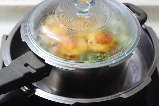 dum process on a hot tawa to make hyderabadi egg biryani