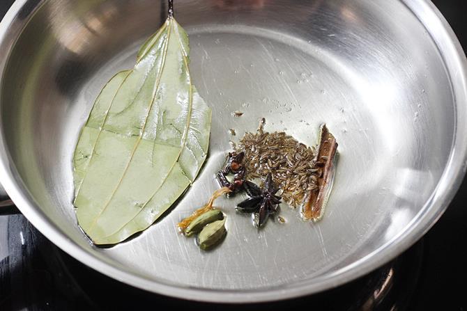 sauteing dry spices in pan for semiya biryani recipe