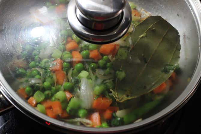 cooking veggies in pan to make semiya biryani recipe
