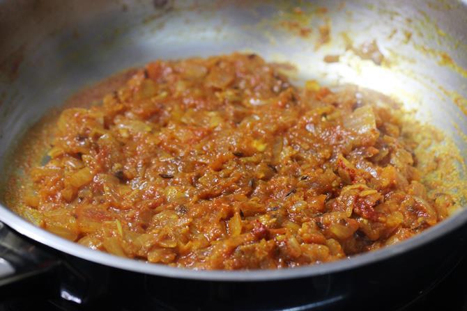 frying onion tomato mixture for potato egg curry recipe