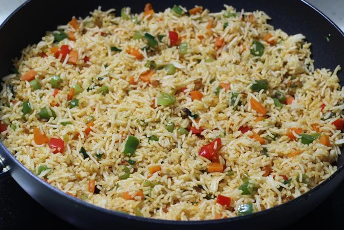 garnished restaurant style schezwan fried rice recipe