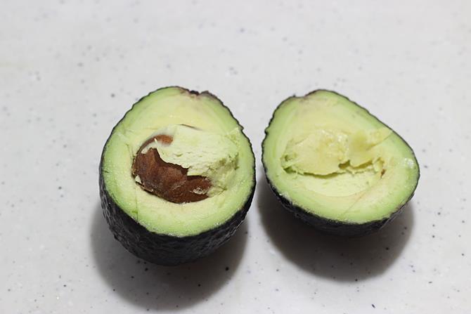 halve the ripe fruit to make avocado dip