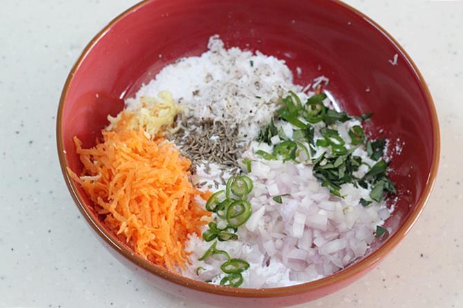 adding flour veggies to a bowl