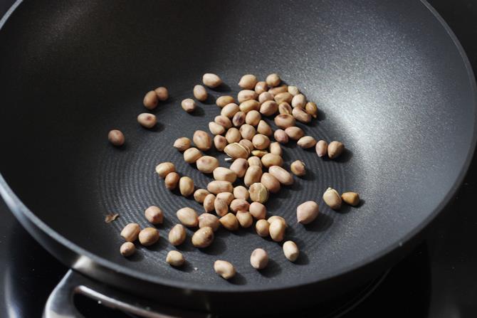 roasting peanuts in skillet for mirchi ka salan recipe