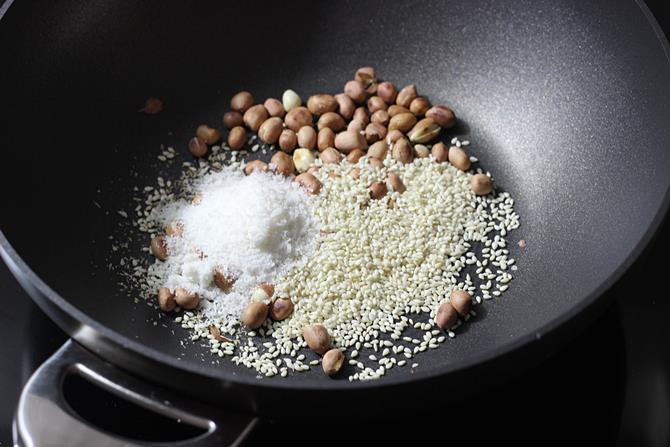 toasting sesame coconut to make mirchi ka salan recipe