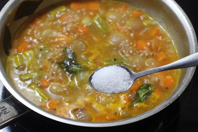 addition of salt to make sambar sadam recipe