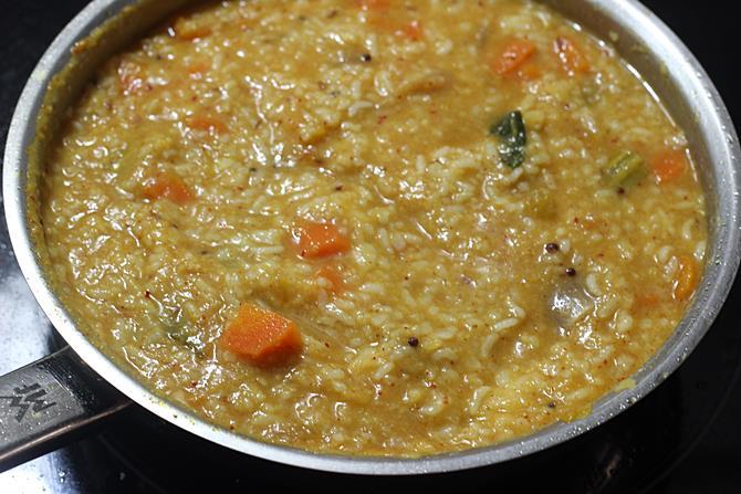 simmering sambhar masala to make sambar sadam