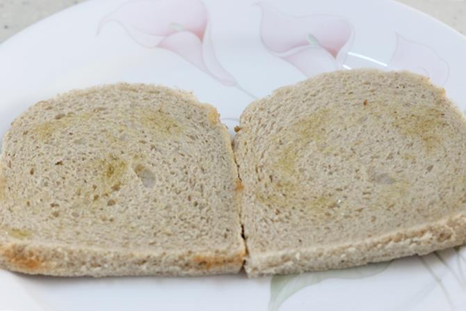 applying ghee on bread