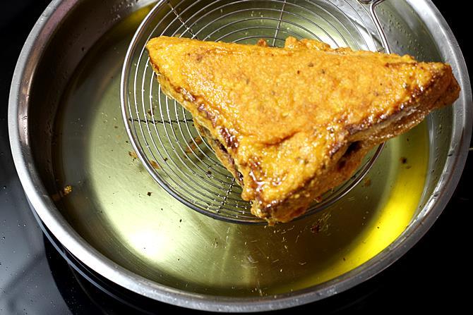 golden fried bread pakora in pan