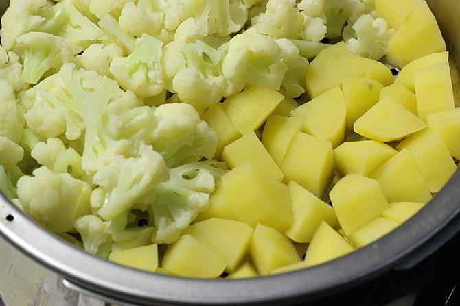 steaming potatoes and cauliflower