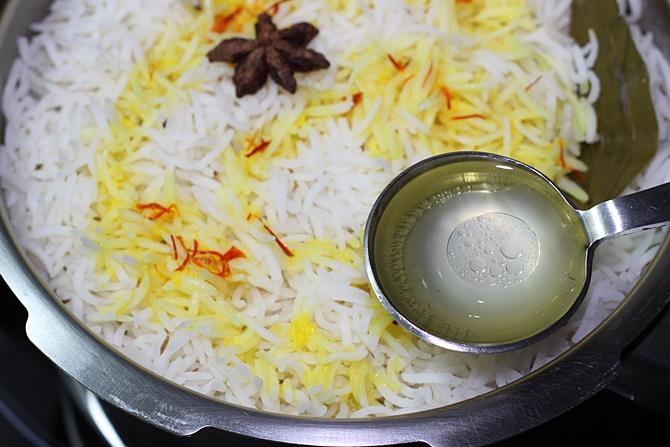 rice water mix with ghee to top dum mutton biryani
