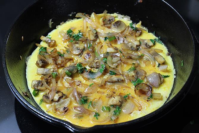spreading mushrooms onions