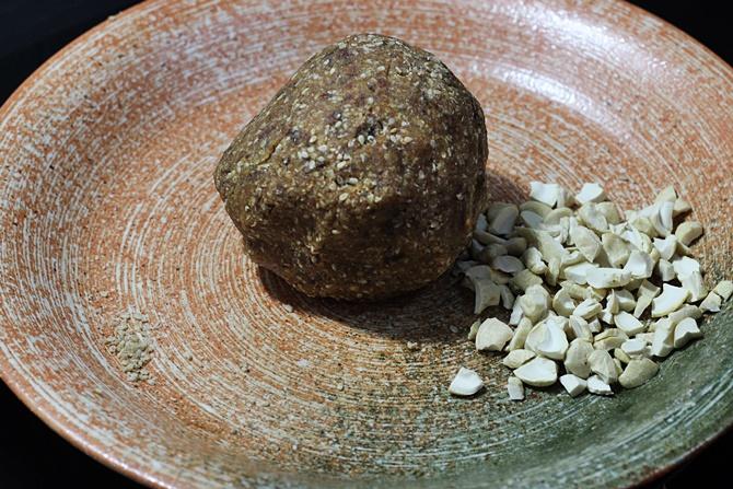 add nuts to make dates sesame ladoo recipe