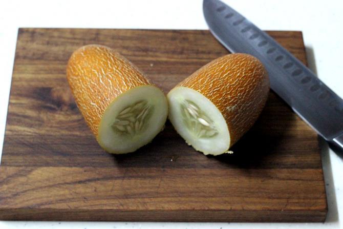 chopping cucumber for dosakaya pickle recipe